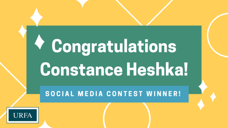 "Text says,"" Congratulations Constance Heshka! Social media contest winner! The URFA logo is in the bottom left corner. The background is yellow with white outlines of shapes."