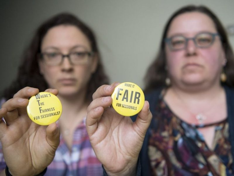 Photo of URFA members holding Make It Fair For Sessionals buttons.